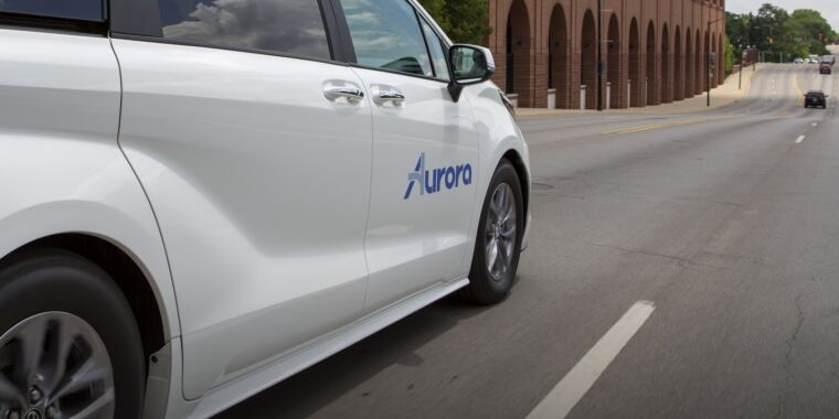 Technology Toyota partners with startup Aurora to develop self-driving taxis