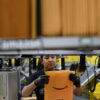Technology Amazon fights high warehouse turnover with offer of free college tuition